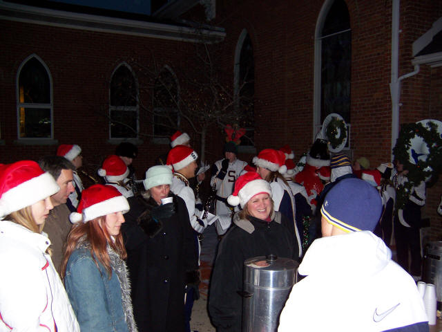 Saline High School Marching Band playing Christmas Carols while Trinity Lutheran Church members pass out free coffee and hot ch